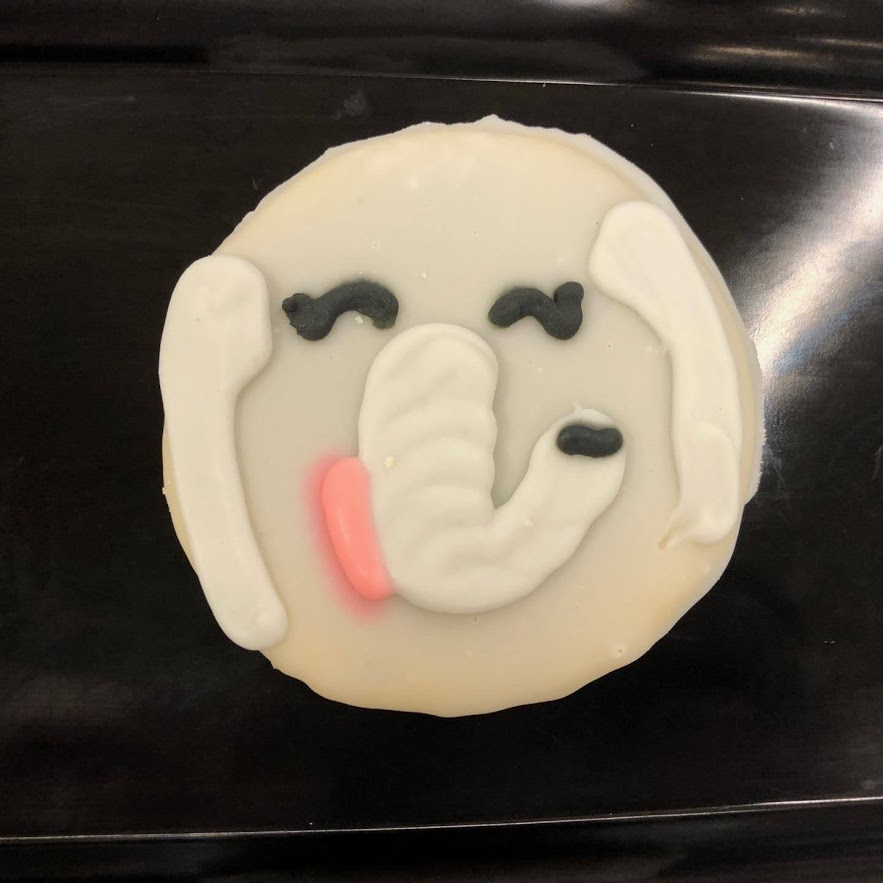 A frosted cookie decorated to look like an elephant.