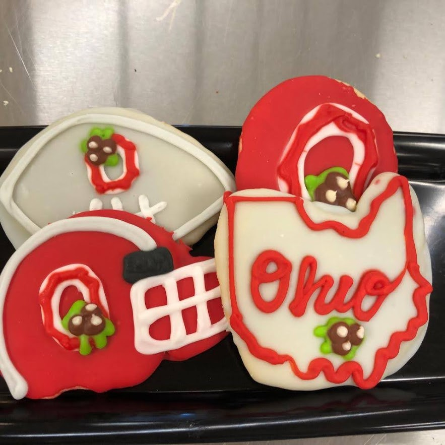Four frosted cookies decorated with Ohio State University football themed patterns.